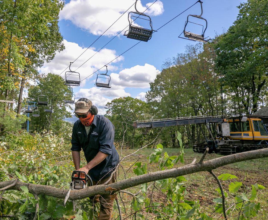 Maintenance worker John Galuska cuts through a small tree while clearing brush and overgrowth along the Boomerang trail at Mount Southington, Wed., Sept. 30, 2020. The ski area is preparing for the upcoming season. Dave Zajac, Record-Journal