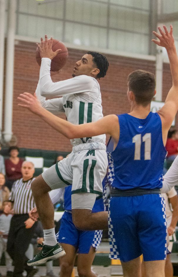 Vincent Martinez scored a season-high 35 points to lead the Maloney boys basketball team to a 66-63 victory Saturday over visiting New Milford. | Aaron Flaum, Record-Journal