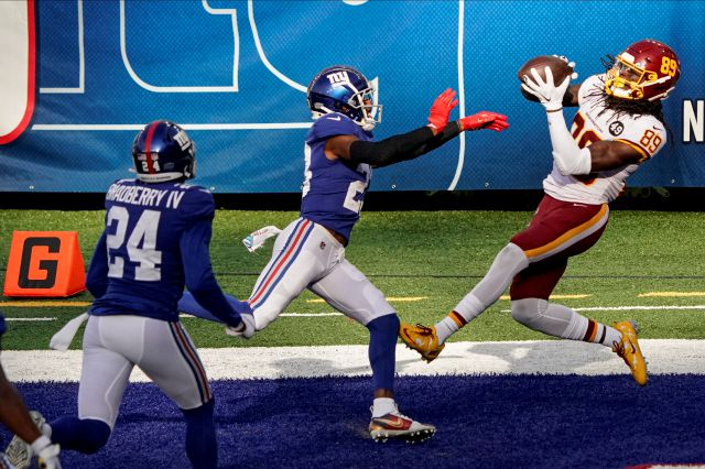 Washington Football Team wide receiver Cam Sims (89) catches a pass for a touchdown in front of New York Giants