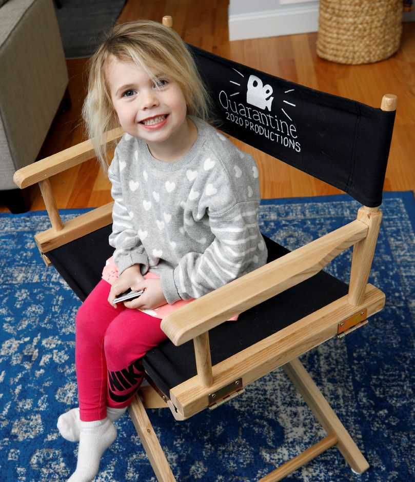 Maddie Presser, 4, of Southington, sits in her director