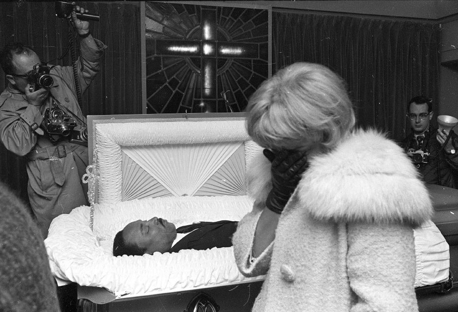 An unidentified woman weeps at the R.S. Lewis funeral home in Memphis, Tenn., as hundreds of mourners filed past the body of civil rights leader Dr. Martin Luther King, Jr., April 5, 1968, before it was to be sent to Atlanta for burial. (AP Photo/Charles Kelly)