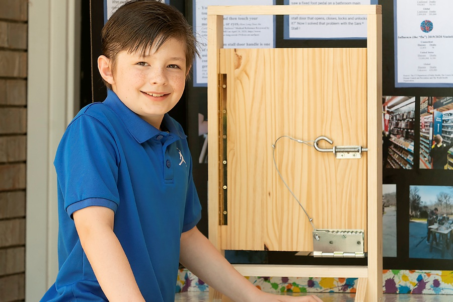 Pond Hill Elementary School fourth-grade student JC Dellaselva, 9, of Wallingford, shows a model of his hands-free restroom stall door invention he calls Sani * Stall, Fri., May 22, 2020. JC is one of two local elementary schoolers in the running to have their homemade gadgets win the national Invention Convention. Dave Zajac, Record-Journal