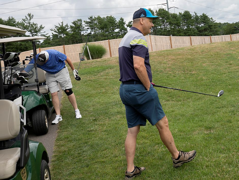 Lou DiMeo, of Wallingford, left, and Dawson McNew, of West Haven, right, prepare for a round at Tradition Golf Club, 37 Harrison Rd., Wallingford, Wed., Jul. 15, 2020. Tradition Golf Club has been averaging more than 200 golfers per day. Dave Zajac, Record-Journal