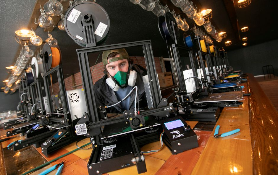 Nikolas Thomson, of Southington, is making 3-D printed face shields and other protective equipment for health care workers and first responders on Friday. Thomson and his friends, fellow Southington residents Evan D'Agostino and Drew Steindl, have set up shop in the building previously occupied by Hop Knot craft beer and gourmet pretzel bar on Meriden-Waterbury Turnpike in Plantsville.