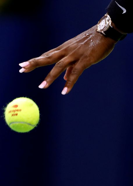 Serena Williams, of the United States, bounces the ball before a serve to Karolina Pliskova, of the Czech Republic, during the quarterfinals of the U.S. Open tennis tournament Tuesday, Sept. 4, 2018, in New York. (AP Photo/Adam Hunger)