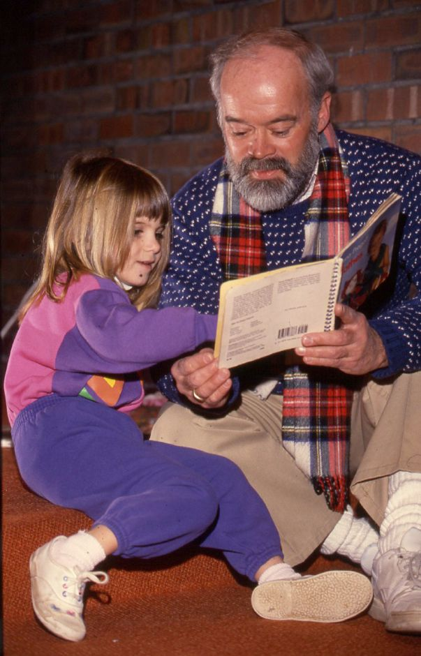 RJ file photo - Ian Hunter reads to his 3-year-old daughter, Kit, in the children