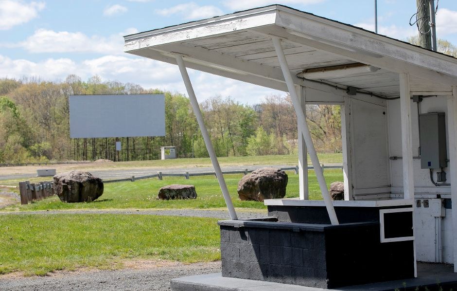 In this Tuesday, May 12, 2020, photo, vintage ticket booths are empty at the Southington Drive-In on Meriden Waterbury Turnpike in Southington, Conn. Town leaders might announce this week whether the drive-in will open. (Dave Zajac/Record-Journal via AP)
