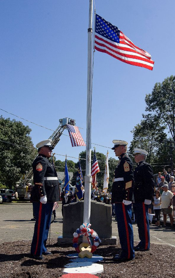 Members of the Silver City Meriden Marine Corp. League raised an American flag that was flown over Ground Zero in New York City, at the 9/11 remembrance ceremony at the American Legion Post 45 in South Meriden on Saturday September 10, 2011. (Matt Andrew/ Record-Journal)