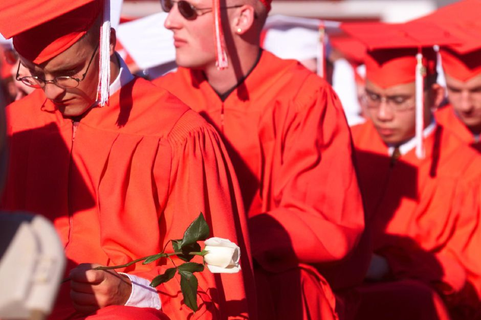 RJ file photo - Valter Bojka (cq) holds on to a white rose and listens to a speach by one of his classmates, Salutatorian Justin Carroll during Cheshire High School