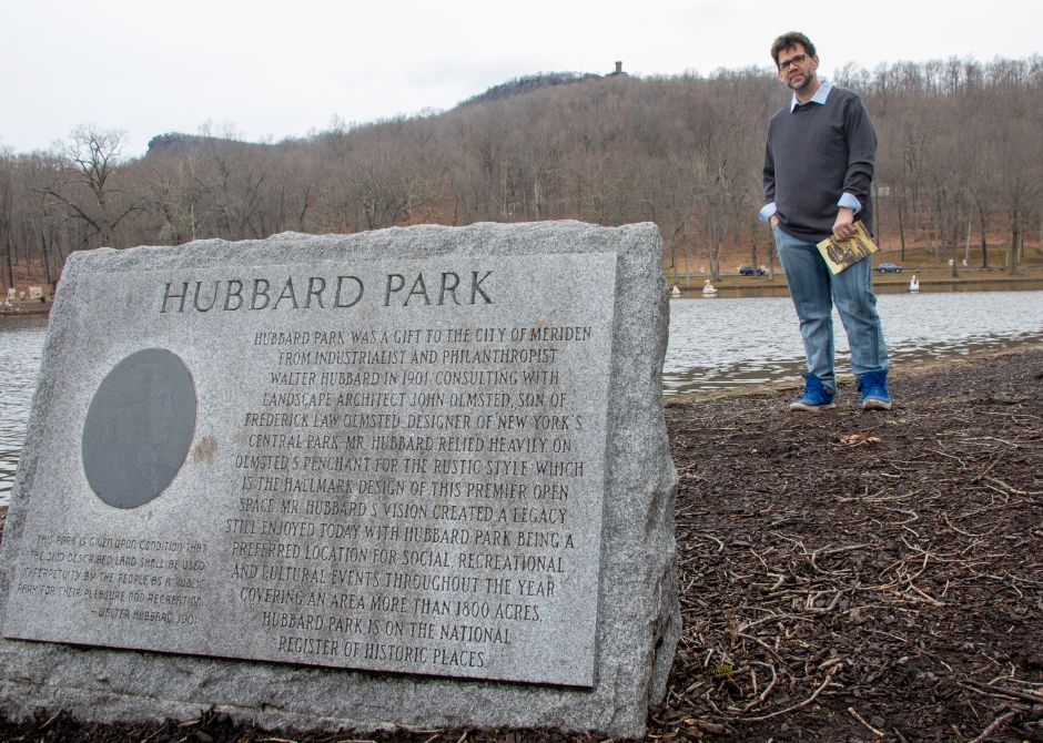 "Justin Piccirillo next to Mirror Lake at Hubbard Park in Meriden on Dec. 31, 2020, with his book ""Hubbard Park (Images of America).""  Aaron Flaum, Record-Journal"