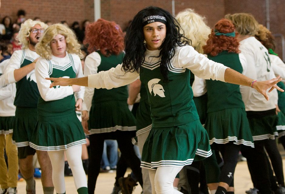 Maloney Spartans powder puff cheerleader, Brandon Hernandez, 17, performs with the squad during the annual pep rally at Maloney High School, Wednesday, November 23, 2016. | Dave Zajac, Record-Journal