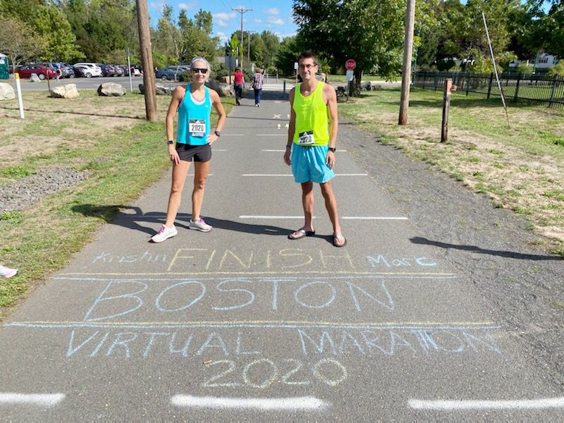 "Southington residents Kristin Lopa, left, and Marc Lennon pose at the ""finish line"" on the Southington linear trail after completing the vritual Boston Marathon on Saturday. Photo courtesy of Kristin Lopa"