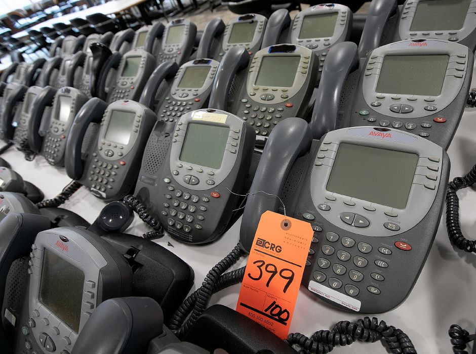 Dozens of phones up for auction in the former Bristol-Myers Squibb in Wallingford, Fri., Jan. 25, 2019. Dave Zajac, Record-Journal