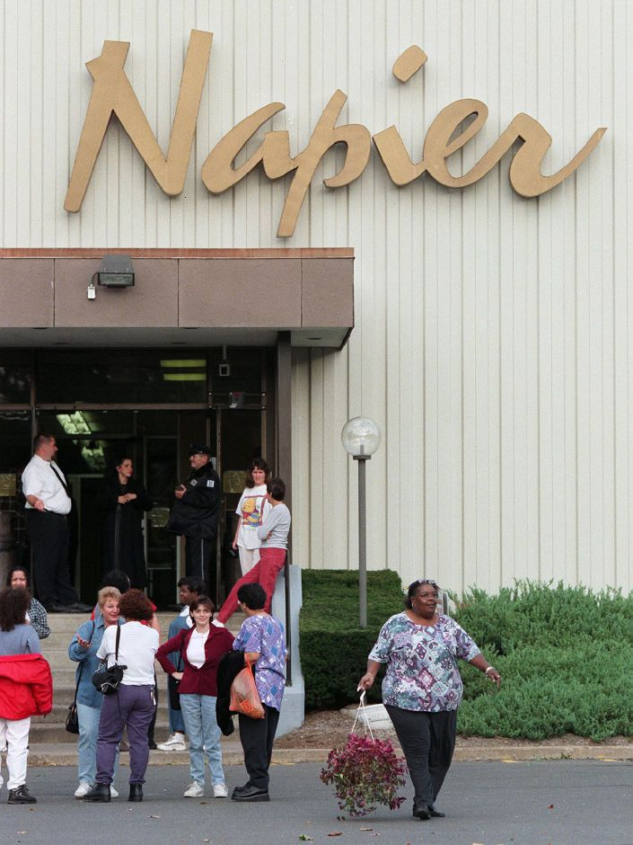 Workers congregate outside the main entrance of The Napier Company after learning of the company-wide layoff Wednesday afternoon Oct. 13, 1999.