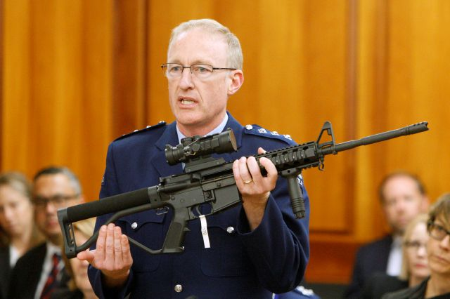 FILE - In this April 2, 2019, file photo, police acting superintendent Mike McIlraith shows New Zealand lawmakers an AR-15 style rifle similar to one of the weapons a gunman used to slaughter 51 worshippers at two Christchurch mosques, in Wellington, New Zealand. New Zealand authorities said Saturday, Dec. 21, 2019, their country will be a safer place after gun owners handed in more than 50,000 guns during a buyback program after the government banned assault weapons. But critics say the process was flawed and many owners have illegally stashed their guns. (AP Photo/Nick Perry, File)