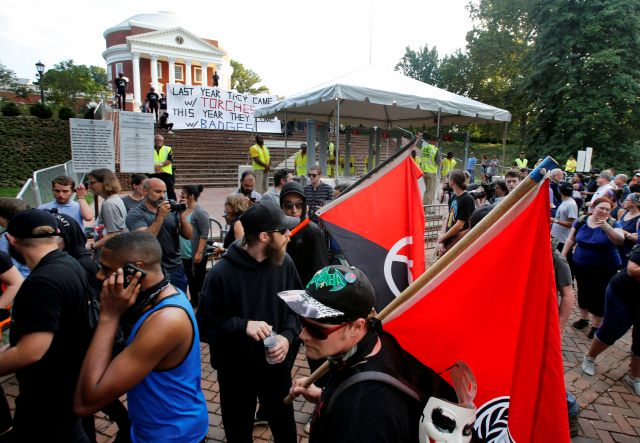 FILE - In this Saturday, Aug. 11, 2018 file photo, a group of anti-fascist and Black Lives Matter demonstrators march in front of the Rotunda on the campus of the University of Virginia in anticipation of the anniversary of the previous year