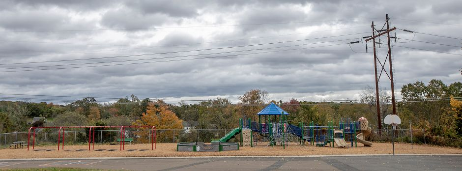 The playground at Pond Hill Elementary School next to power lines. After a request by Eversource, the Board of Education approved funding to move and rebuild the playground.