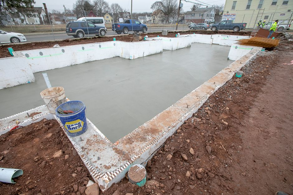 Cement settles in the crawl space of Hanover Place Veterans Housing on Hanover Street in Meriden, Mon., Jan. 13, 2020. Dave Zajac, Record-Journal