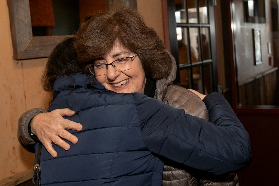 Above left, Mary Lou DiPaola hugs her former Washington Middle School student, Allaa Arbach, 30, of Wallingford, after 16 years.