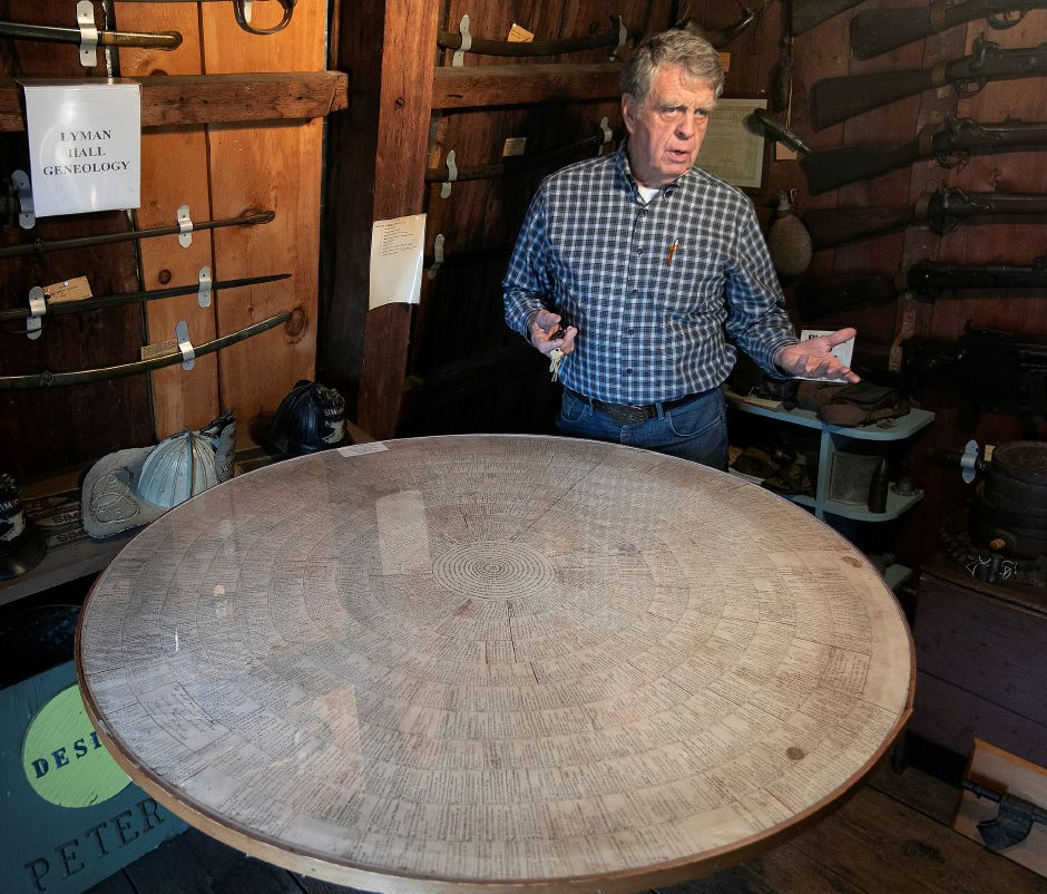 Bob Beaumont talks Wenesday about the Hall Wheel of Genealogy, which features prominent names Winston Churchill and Lyman Hall, at the Wallingford Historical Society. Dave Zajac, Record-Journal
