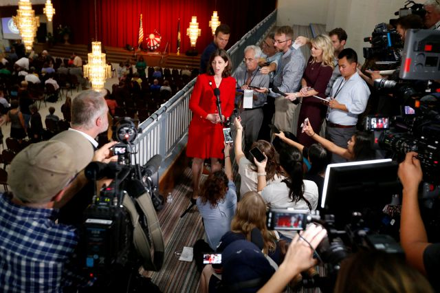 Rep. Elaine Luria, D-Va., center at microphone, answers reporters questions during a press conference prior to a town hall at a church in Virginia Beach, Va., Thursday, Oct. 3, 2019. Luria recently joined a group of other Congresswomen to call for the impeachment of President trump. (AP Photo/Steve Helber)