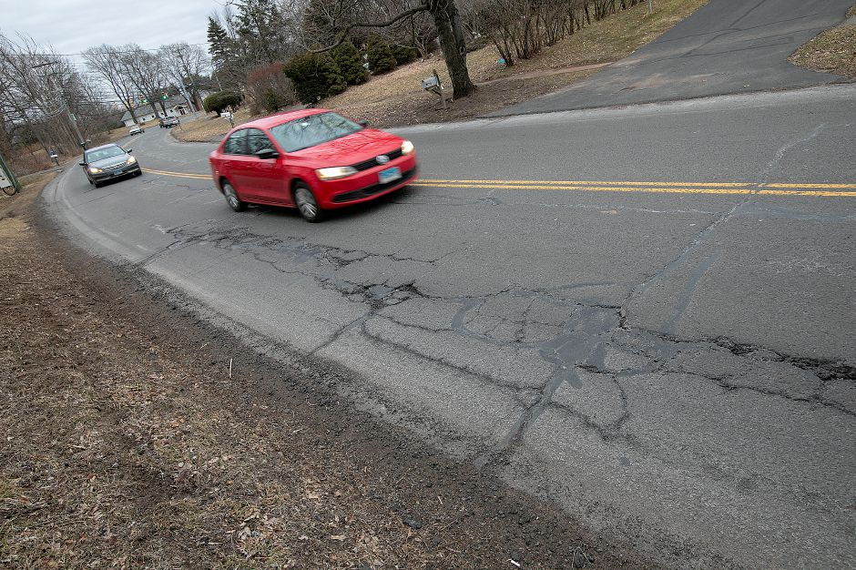 Motorists travel on Paddock Avenue in Meriden, Wed. Feb. 6, 2019. Cold temperatures and an early snow storm led to scarring of freshly paved roads according to city officials. Dave Zajac, Record-Journal