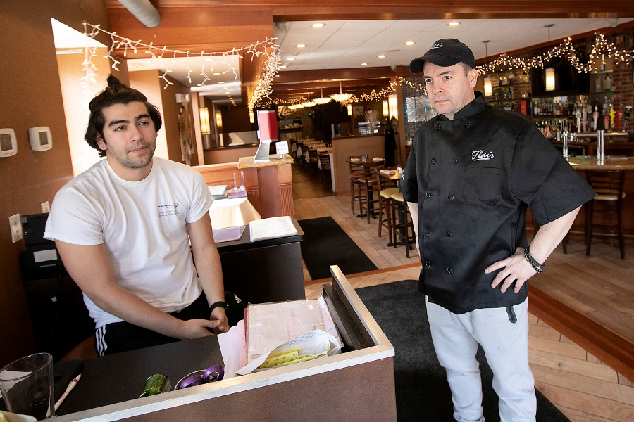 Jose Delgado, left, and father, Hector Delgado, owners of Flair Restaurant and Bar at 98 Main St. in Southington, Mon., Mar. 16, 2020. The business will offer curbside pick up for food and they are working on delivery options. Dave Zajac, Record-Journal