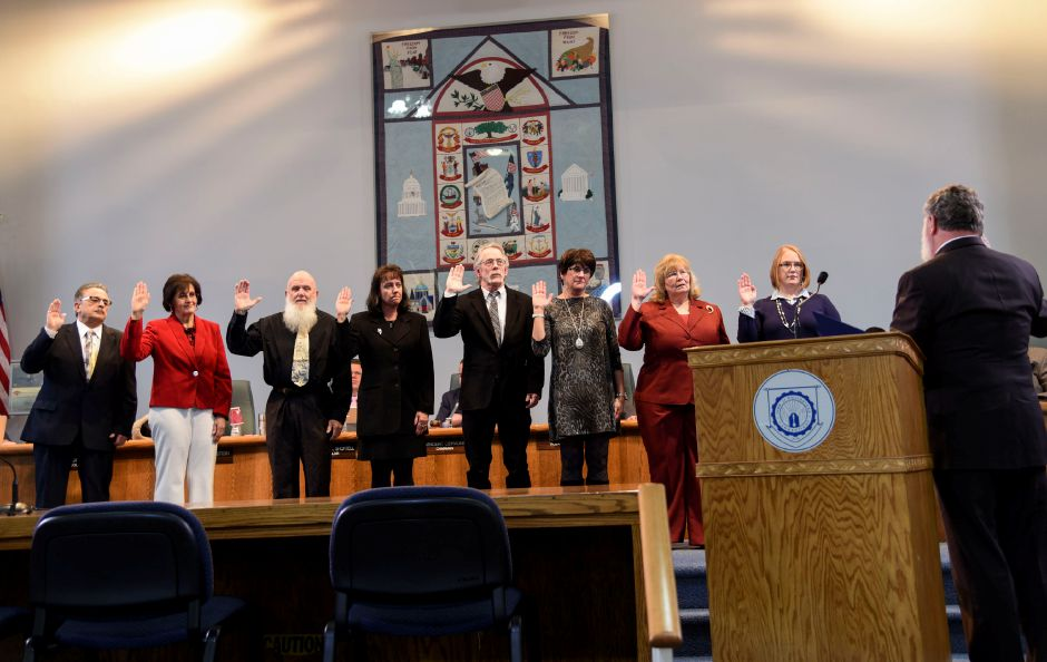 Wallingford Board of Education members are sworn into the 2018-19 term during a ceremony at Town Hall on Jan. 8. Board members left to right: Michael Votto (D), Kathy Castelli (D), Ray Ross (R), Tammy Raccio (D), Roxane McKay (R), Karen Hlavac (R), and Erin Corso (R). | Matthew Zabierek, Record-Journal
