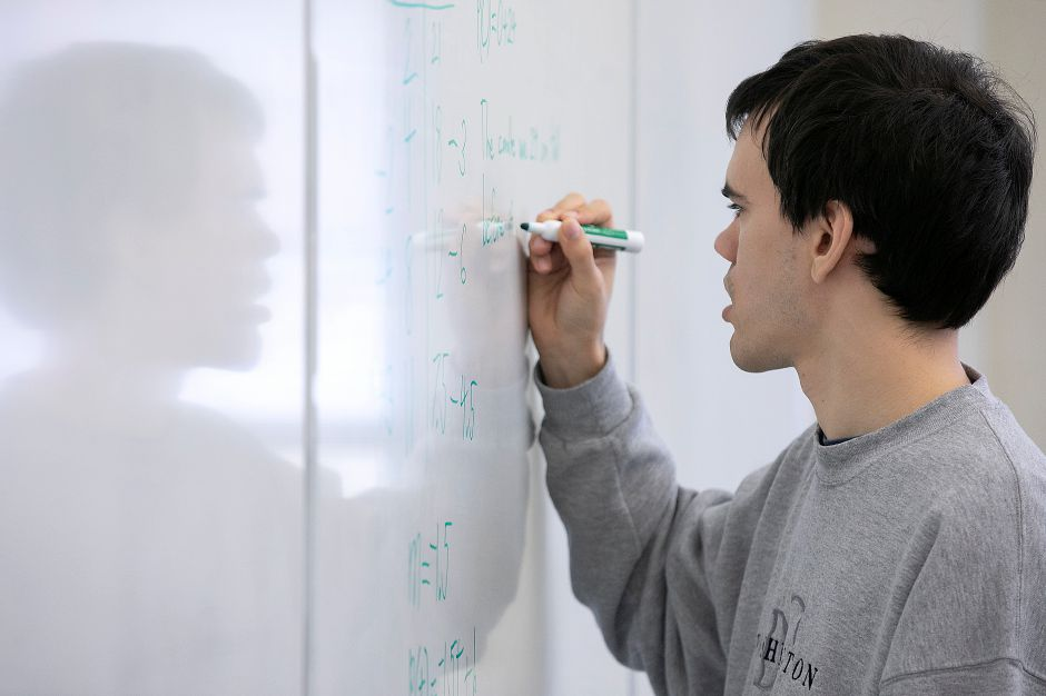 Alex Cable, 26, works on a problem in an Intermediate Algebra class at Tunxis Community College in Farmington, Thurs., Mar. 12, 2020. Alex is one of hundreds of young adults with autism in Connecticut that cannot receive support services from the state due to a lack of funding and a waitlist exceeding 1,600 people. Alex is attending Tunxis Community College in hopes of one-day getting a full-time job. Dave Zajac, Record-Journal