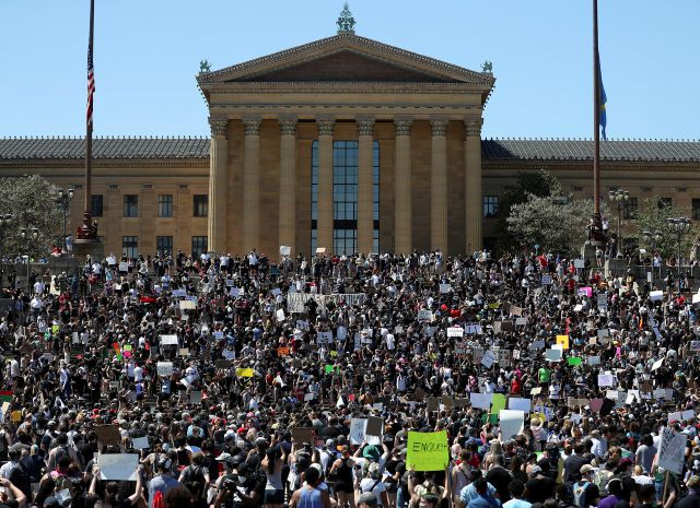 Protesters take to the Art Museum steps in Philadelphia, Saturday, May 30, 2020, during a protest over the death of George Floyd. Floyd died in Minneapolis police custody on May 25. (Heather Khalifa/The Philadelphia Inquirer via AP)