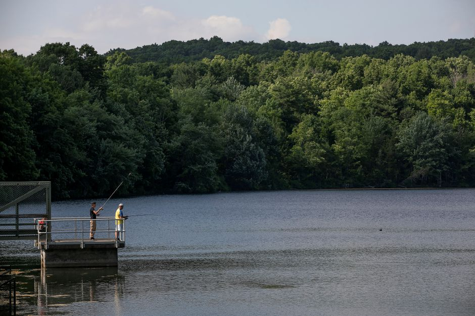 Anglers try their luck from a platform overlooking Crescent Lake in Southington in this 2020 file photo. A woman and six-month-old were safely located Friday after being reported lost while hiking around the lake. | Dave Zajac, Record-Journal