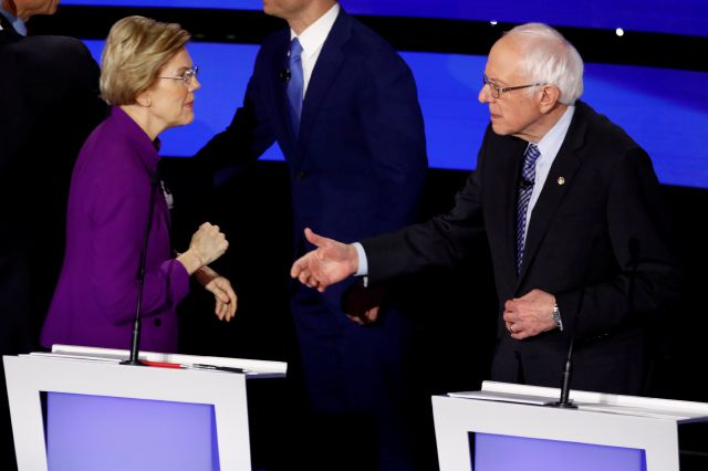 Democratic presidential candidate Sen. Elizabeth Warren, D-Mass., left and Sen. Bernie Sanders, I-Vt. talk Tuesday, Jan. 14, 2020, after a Democratic presidential primary debate hosted by CNN and the Des Moines Register in Des Moines, Iowa. (AP Photo/Patrick Semansky)
