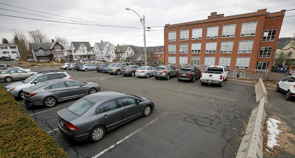 Simpson Court rear parking separated by concrete barriers in Wallingford, Fri., Jan. 22, 2021. The Town Council is scheduled to revisit the proposal for parking lot improvements behind Simpson Court businesses and Wallace Avenue at its meeting Tuesday. Holy Angels School is seen, right. Dave Zajac, Record-Journal