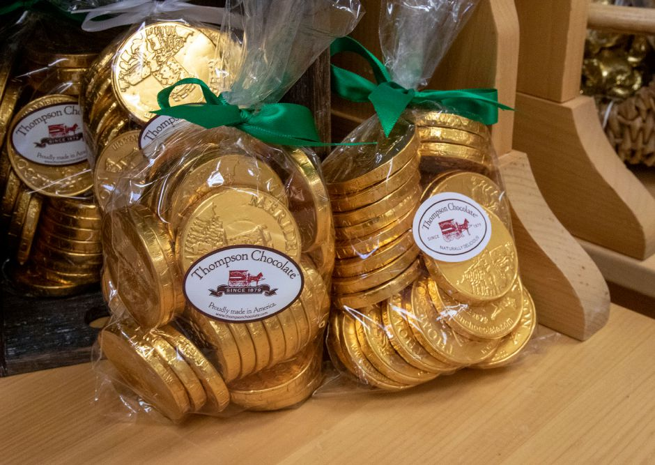 Thompson Chocolate's gold coins are for sale at the recently reopened retail store.