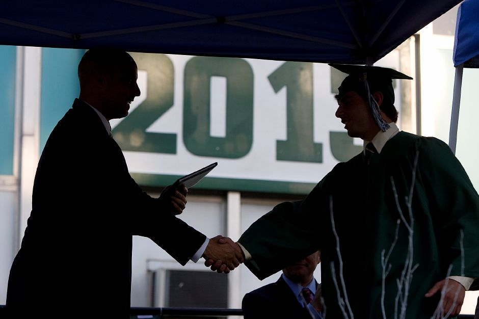 Graduate Dallas DeFrancesco, right, receives his diploma from Board of Education Vice President Michael P. Cardona during commencement ceremonies at Maloney High School, Friday, June 21, 2013. (Dave Zajac/Record-Journal)