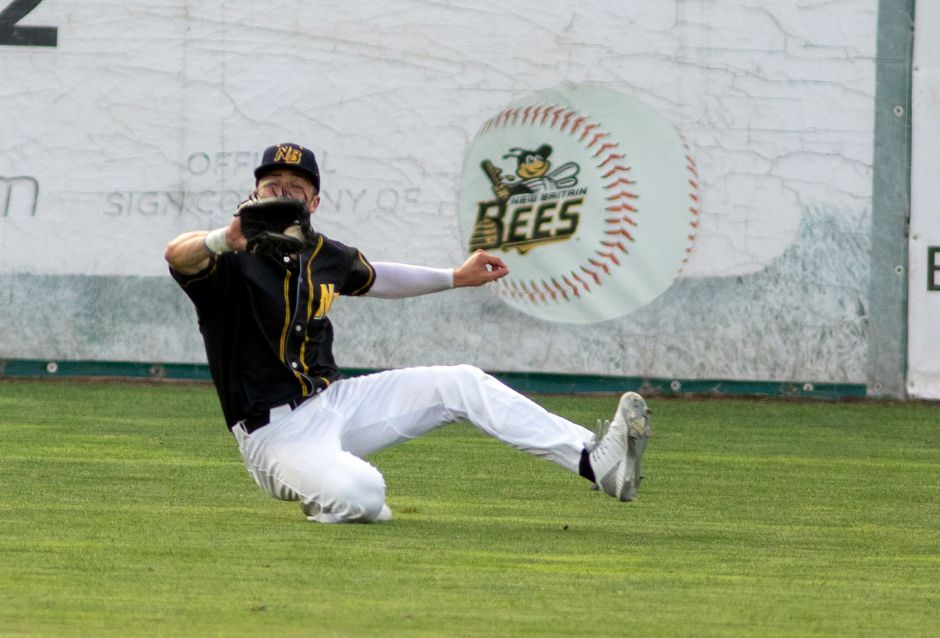 Kyle Brennan makes a sliding catch playing left field for the New Britain Bees in a Futures Collegiate Baseball League game earlier this season against the Worcester Bravehearts at New Britain Stadium. Aaron Flaum, Record-Journal