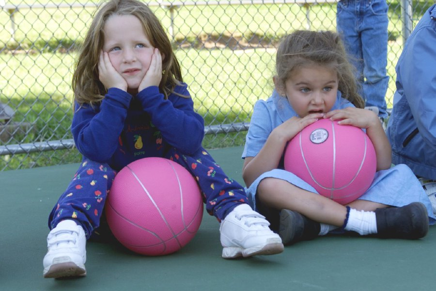 (L) Alison Davis,5, and (R) Rachela Calvi,4 decide what game to play during the Wallingford YMCA afterschool child care program on Wednesday Sept. 7, 2000.