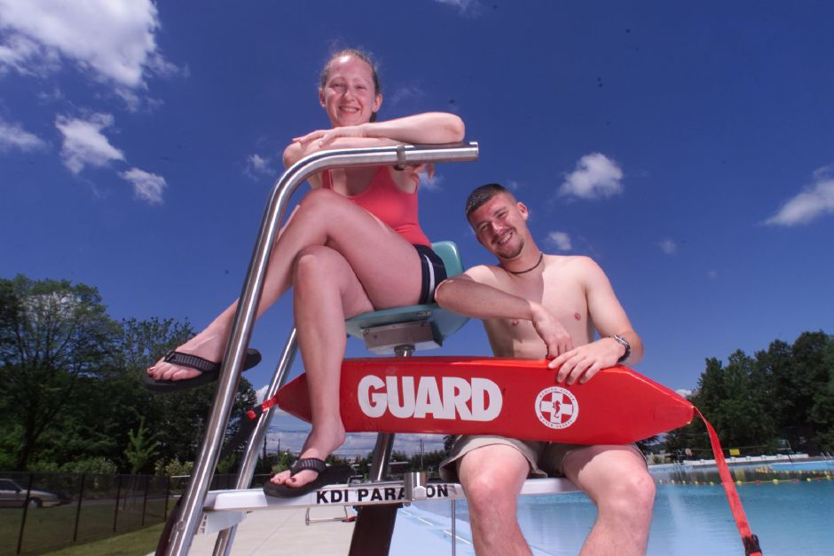Erin Gordon, left, and Erik Seitz, right, are both pool programmers at the Wallingford Community Pool in Wallingford June 23, 2000. They are also both attending colleges.