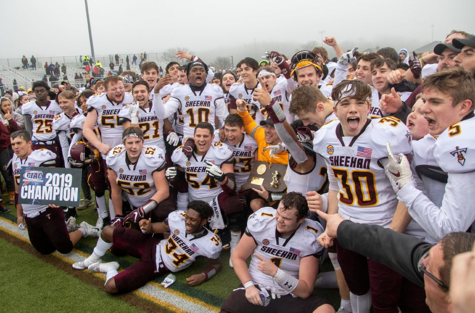 The Sheehan football team celebrates after beating Bloomfield in the CIAC Class S championship game at Trumbull High School on Dec. 14, 2019. It was Sheehan's first state championship in football since 1985. Aaron Flaum, Record-Journal