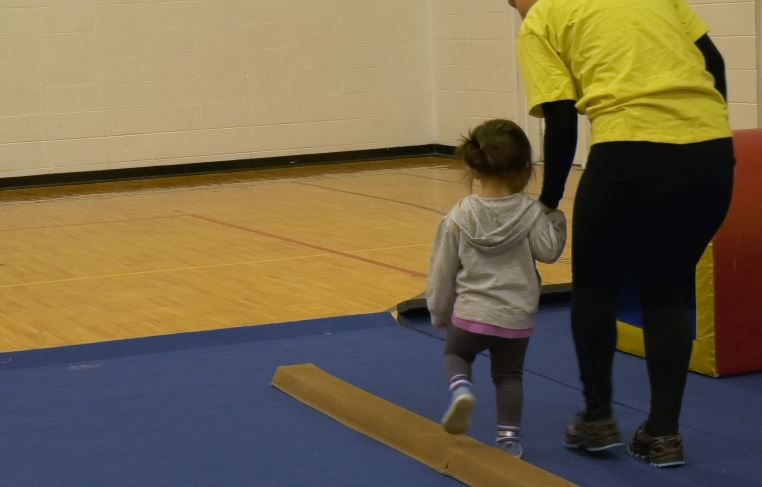 Morgaine Degnan helped toddlers try out the new gymnastics program at Wallingford Family YMCA, 81 South Elm Street Wallingford, Dec. 17, 2018. |Ashley Kus, Record-Journal