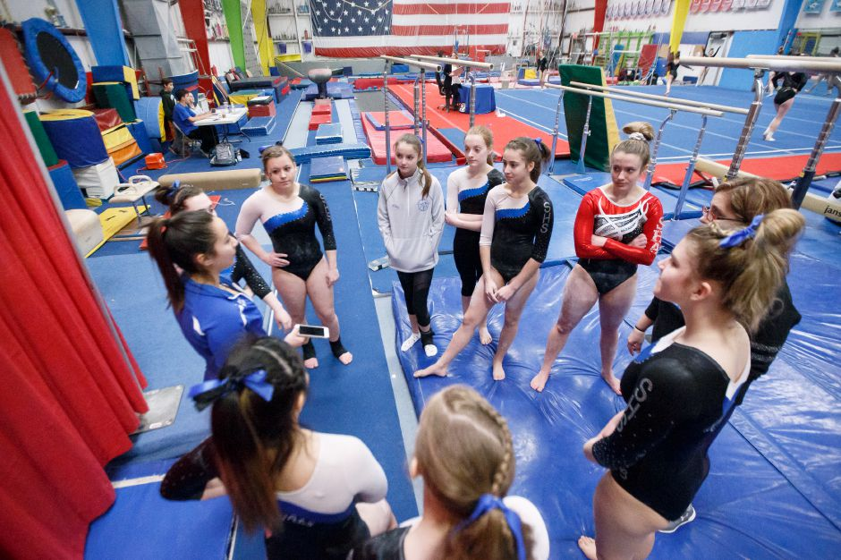 Southington Gymnastics prepares for Farmington Monday at American Gymnastics in Plantsville February 19, 2018 | Justin Weekes / Special to the Record-Journal