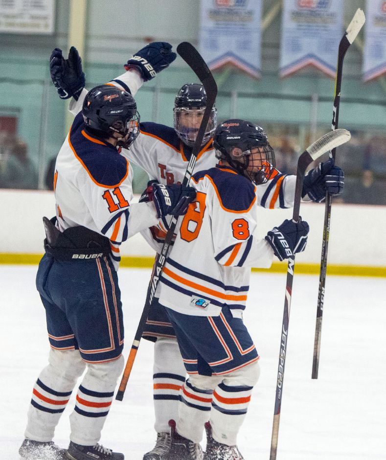 Matt Pettit (11), Jack Roberts (8) and Connor Chordas had a 5-4 overtime victory to celebrate Wednesday at the Northford Ice Pavilion. The Lyman Hall Co-op, powered by Pettit's hat trick, defeated the Eastern CT Eagles. | Aaron Flaum, Record-Journal