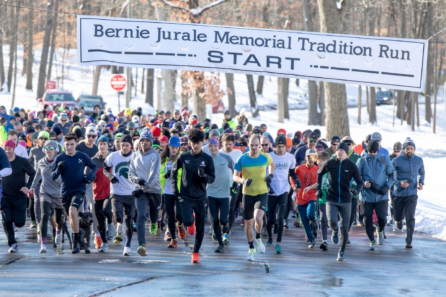 Runners in the Bernie Jurale Memorial Tradition Run take off from the starting line at Hubbard Park in Meriden on Jan. 19, 2020. The annual run, now in its 51st year, goes three miles up Peak Drive to Castle Craig. | Devin Leith-Yessian