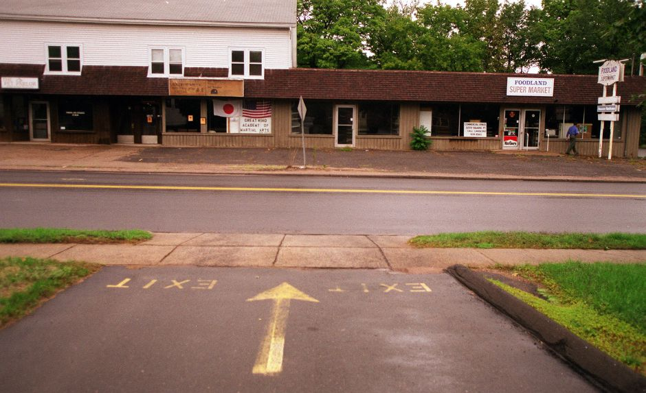 A strip of stores that are mostly vacant in South Meriden, Oct. 1999.