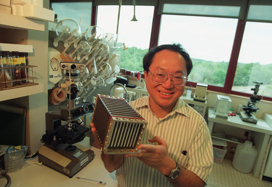 Raymond Lam, Ph.D. , senior principal scientist natural products research at Bristol-Myers Squibb in Wallingford, holds an experiment container he worked on that went up in the Space Shuttle. Lam experiments with drug research in zero gravity.