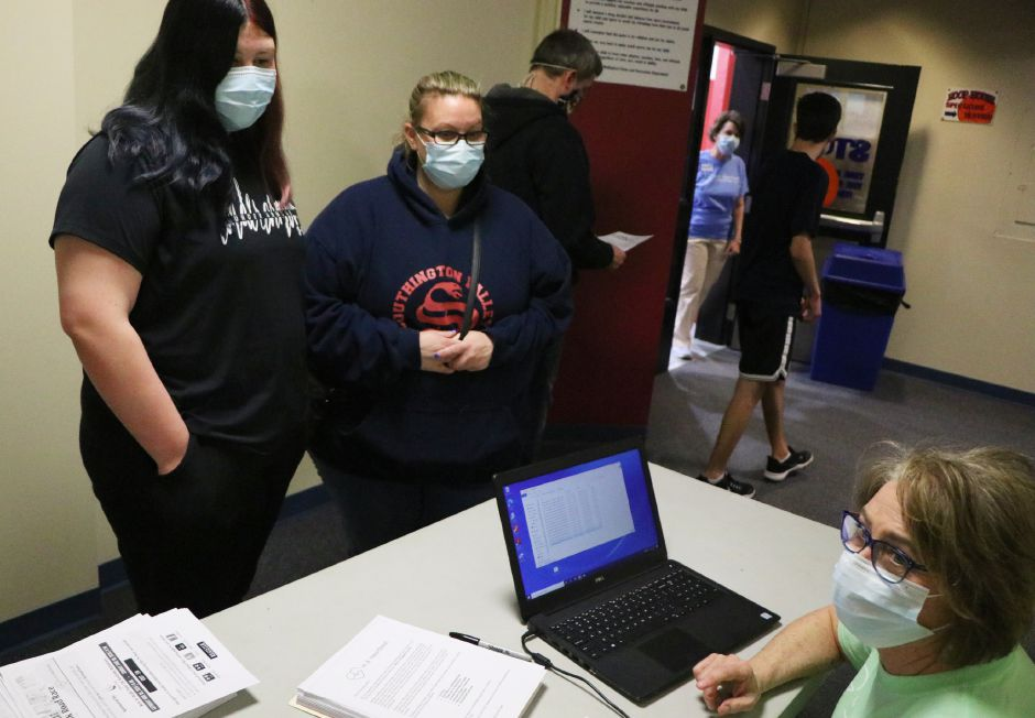 Kim Bailey awaits her test results with her daughter, Aubrey Bailey, and son, Hunter Bailey, during a heart screening clinic provided by the In A Heartbeat Foundation on Sunday, April 18, 2021 at Wallingford's Parks and Recreation Center | Record-Journal, Nadya Korytnikova