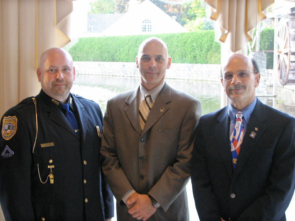 Left to right, Officer Michael Hadvab of the Meriden Police Department, Officer Brian Schechter of the Cheshire Police Department, and John Palmeri, Master of Ceremonies and member of the Cheshire Exchange Club. Schechter and Palmeri were honoree