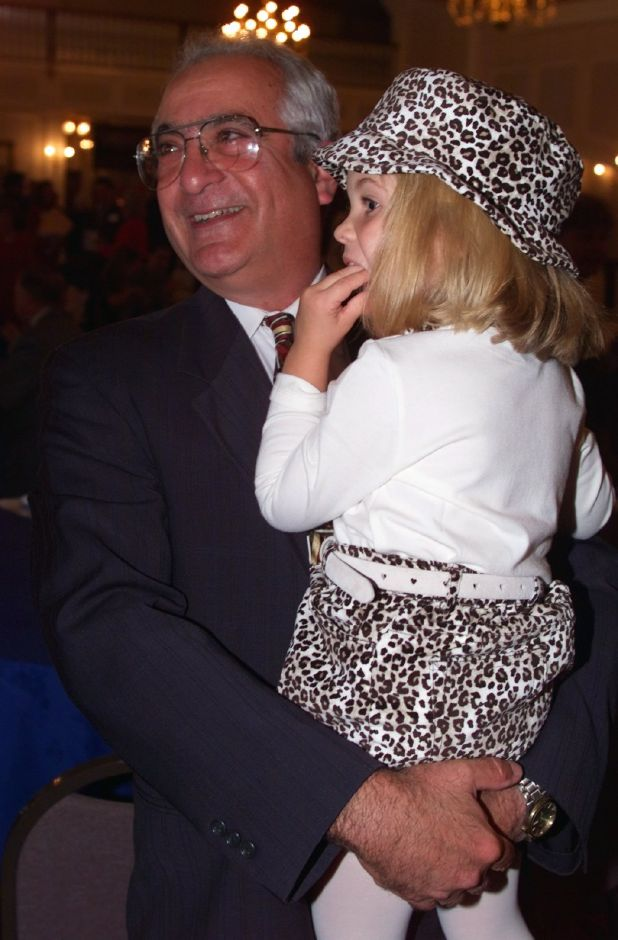 Ted Horwitz holds his granddaughter Alexandra Horwitz, 4, while greeting guests at the Aqua Turf in Southington Wed., Sept. 22 1999 during a good-bye party held by MidState Medical Center
