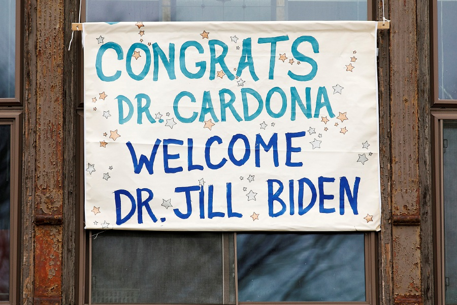 "A sign hung from the second floor of Gallery 53 on Colony Street in Meriden Monday  reads ""Congrats Dr. Cardona, Welcome Dr. Jill Biden.""Dave Zajac, Record-Journal"