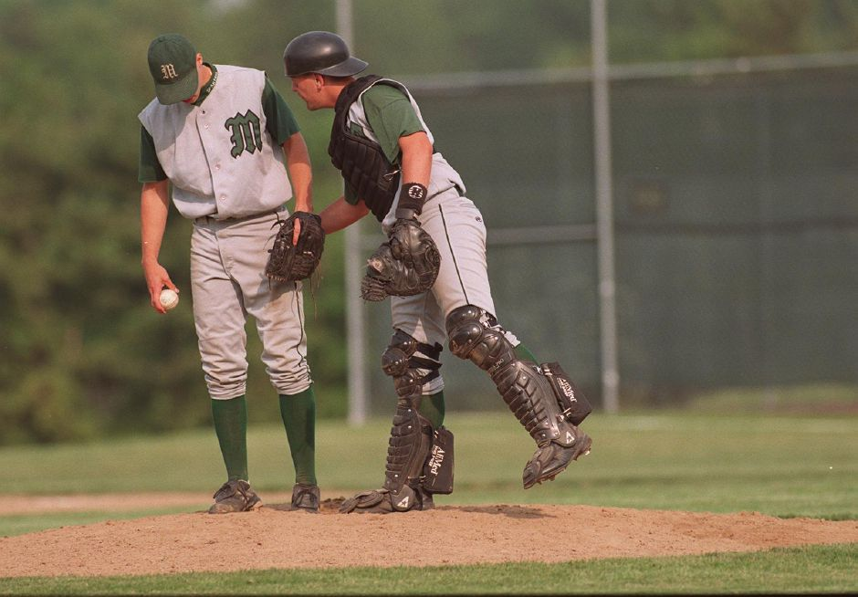 Josh gives the Maloney pitcher a little encouragment during a tough inning with their game against Ledyard, June 1999.